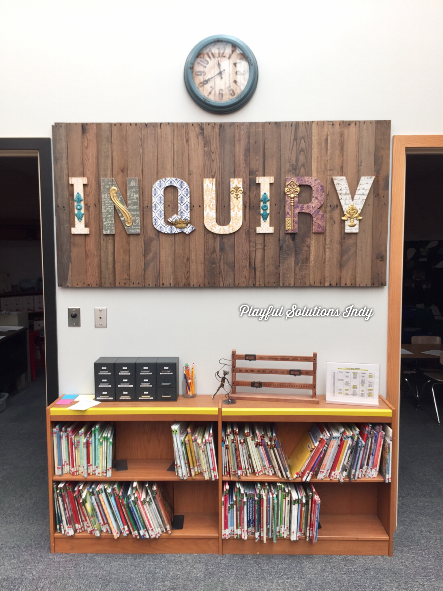 "a large sign over a bookcase reading ""Inquiry"""